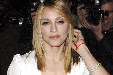 Celebrity Madonna wears a Kabbalah red string bracelet
